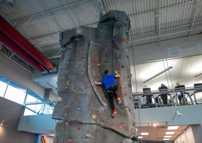 Climbing on the Indoor Rock Wall at Workout Club in Salem